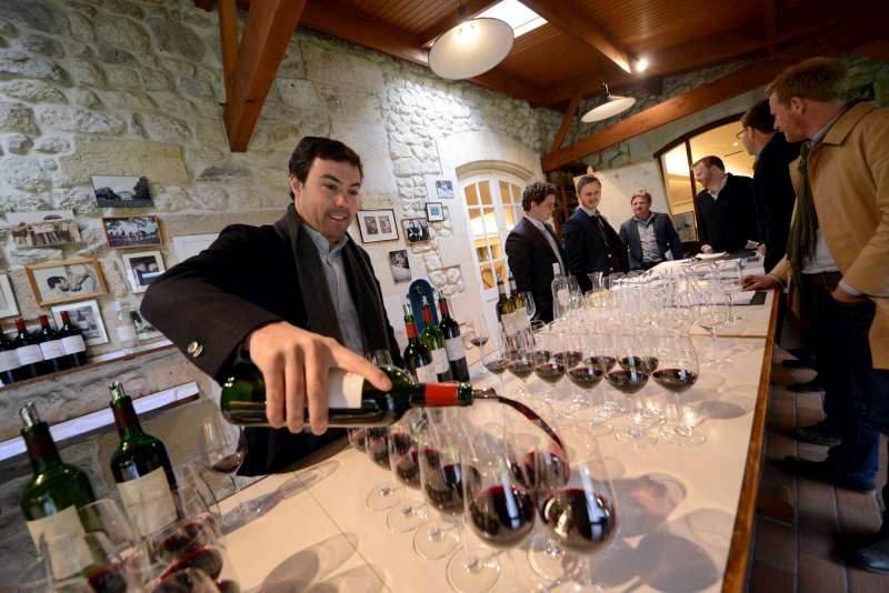 Jean-Charles Cazes prepares samples at Lynch Bages