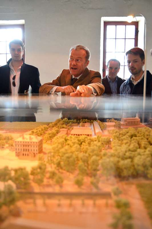 Paul Pontallier shows the team the new construction plans for Château Margaux