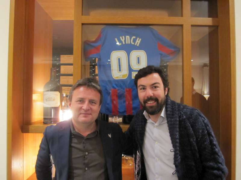 Stephen Browett and Jean-Charles Cazes pose with a Lynch Bages Crystal Palace shirt